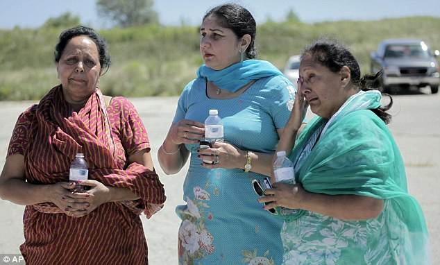 Members of the Sikh temple in Wisconsin await more information